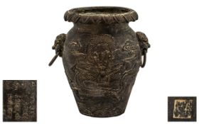 Chinese Bronze Vase - cast to the body with a coiling dragon, with lion mask handles.