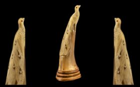 "Oriental Carved Horn - depicting a peacock on a wooden base. 11"" high."