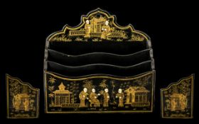 Antique Paper Mache Letter Rack black lacquered decorated with Chinese men in a garden pavilion
