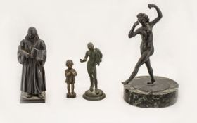 Collection of Four Small Figures comprising a bronze little girl praying and measuring 2.