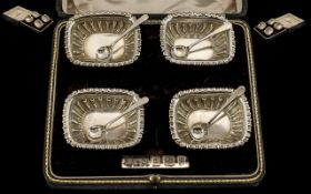 Edwardian Period Nice Quality Boxed Set of Four Sterling Silver Salts with spoons.