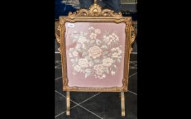 1930's Embroidered Fire Screen in Giltwood carved frame with shape feet supports. 30'' high, 22''