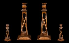 Arts and Crafts Fine Pair of Carved Oak Candlesticks of sinuous design/form. Raised on square bases.