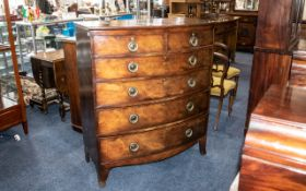 A Late Regency Period/ Georgian Large Bow Fronted Mahogany Chest with graduating drawers.