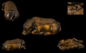 Japanese Early 20th Century Carved Boxwood Netsuke In The Form of a Wart Hog In Resting Position,