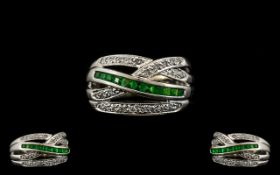 14ct White Gold - Attractive Contemporary Design Emerald and Diamond Dress.