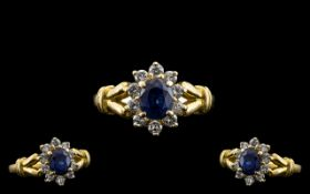 18ct Gold Attractive Sapphire and Diamond Set Cluster Ring - Flower head Setting. Mark 750 - 18ct.