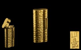 Dunhill Lighter 20 micron gold plated textured case. Serial number E71697.