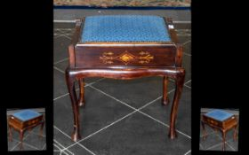 An Edwardian Inlaid Piano Stool with a lift up blue cushioned seat. Raised on cabriole legs.