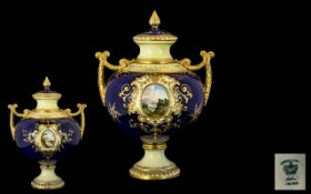 Coalport 19thC Hand Painted Twin Handle Lidded Globular Vase with painted scenic panels of lakes