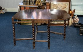 Large 1920's Oak Barley Twist Leg, Drop Leaf Table of Typical Form with Stretchers.