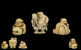 Three Carved Ivory Japanese Netsukes depicting a man with drum,