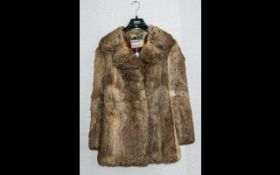Ladies Coney Fur Jacket by Hutcheson of Lancaster. Two slit pockets, hook and eye fastening,