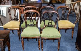 A Set of Six Rosewood Victorian Stand Chairs with shaped and carved backs.