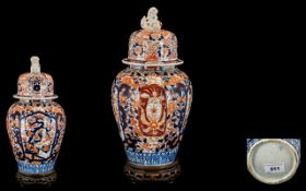 Japanese 19th Century Imari Pallet Lidded Vase. Meiji period 1864 - 1912. Raised on a carved