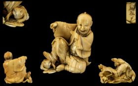 Japanese 19th Century Novelty Fine Quality Ivory Carving of a Seated Figure with his right foot on