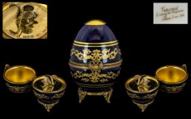 Limoges of France Faberge Egg No.446, in cobalt blue with gilt relief, lid lifts to reveal a swan.