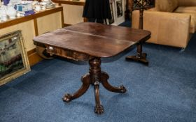 A Regency Period Georgian Mahogany Fold Over Top Tea Table with a bold centred turned column