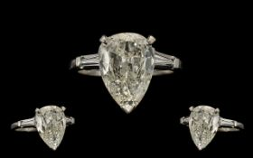 A Fine Quality Platinum and Iridium 8 Single Stone Diamond Set Dress Ring - the large pear shaped