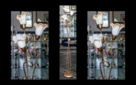 A Modern Three Branch Floor Standing Light in bronzed effect finish with petal shaped frosted