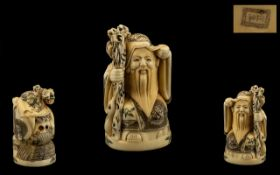 Japanese Early 20th Century Carved Ivory Netsuke of a Wiseman / Sage with Staff signed to underside,