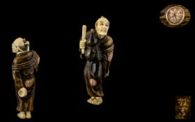 Japanese 19th Century Signed and Superb Quality Carved Stained Ivory Netsuke of a Japanese Male