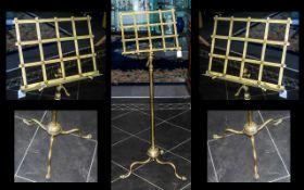A Victorian Brass Telescopic Music Stand, fretwork music rest on a plain telescopic support.