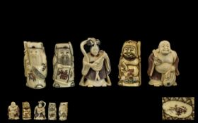 A Collection of Five Japanese Carved Ivory Netsuke depicting a Buddha,
