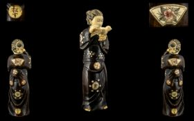 Japanese 19th Century Superb Quality Carved Stained Ivory Figure - Meiji period 1864-1912 of a