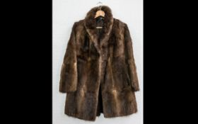 Ladies Three Quarter Length Fur Coat. Shawl collar, hook and eye fastening, fully lined in brown