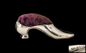 A Silver Pin Cushion in the form of a ladies shoe. Hallmark for Birmingham H 1907. Makers mark R.P.