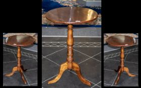 A Small 19thC Mahogany Tripod Based Candle Table with a turned column on a cabriole leg base.