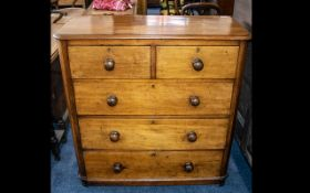 A Victorian Mahogany Chest of Drawers fitted with turned wood handles,