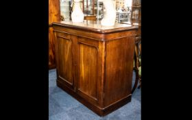 A Victorian Mahogany Two Door Library Cupboard with arched topped doors with rounded corners below