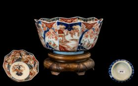 Japanese 19th Century Imari Pallet Bowl raised on a carved ornate wooden display stand. Meiji period
