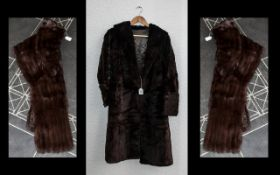 Ladies Dark Brown Full Length Fur Coat. Hook and eye fastening, shawl collar, fully lined in brown