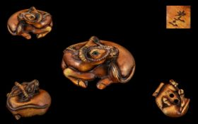 Japanese 19th Century Superb Quality Stained Carved Ivory Netsuke - depicting a water buffalo