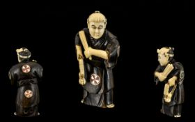Japanese 19th Century Superb Quality Carved Stained Ivory Netsuke depicting a Japanese male figure