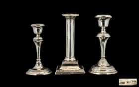 Silver Candle Sticks. Three hallmarked silver candle sticks, total weight 36 ounces.