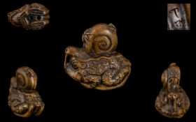 Stained Boxwood Carved Japanese Netsuke of a Toad with Horn Eyes,