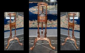 A Small Mahogany Georgian Style Wig Stand with two small drawers terminating on three cabriole legs.