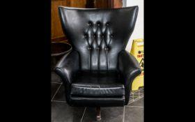 1960s G Plan Style Swivel Chair in black leatherette, rocking/tilt style.