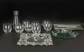 A Modern Carafe and Eight Glasses Set pl