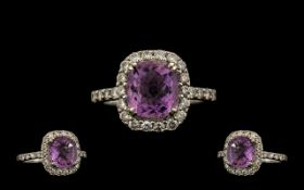 Stunning 18ct White Gold, Amethyst & Diamond Set Dress Ring. Interior of shank Marked 18ct, the