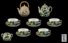 A Japanese Porcelain Tea-Set Decorated to the Body with a Floral Pattern. Meiji Period.