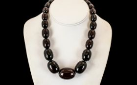 1920's Dark Cherry Amber Graduated Beaded Necklace. Weight 87.5 grams. 16 Inches - 40 cm In length.