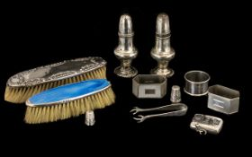 Good Collection of Hallmarked Silver comprising two clothes brushes, a salt and pepper set, pair