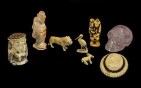 Mixed Lot of Carvings consisting of crystal skull, carved figure, cameo brooch, two Japanese