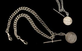 A Good Quality Double Sterling Silver Watch Albert Chain with Attached T-Bone and Fob.