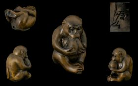 Oriental Carved Boxwood Netsuke, Depicts a Seated Figure of a Monkey Eating a Large Nut.